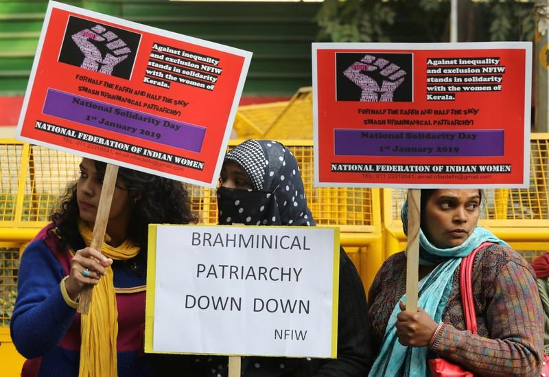 """FILE PHOTO:  Women hold placards in a solidarity rally in support of """"Women's Wall"""" organised by the women in the southern state of Kerala to pledge for gender equality in the southern state, in New Delhi"""