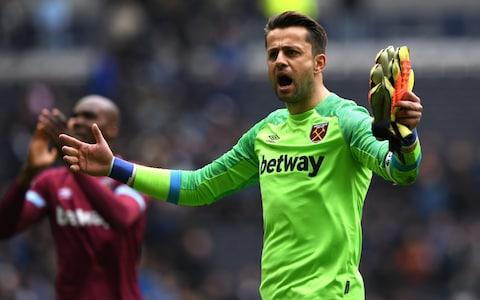 Lukasz Fabianski of West Ham United celebrates victory after the Premier League match between Tottenham Hotspur and West Ham United at Tottenham Hotspur Stadium - Credit:  Shaun Botterill/Getty