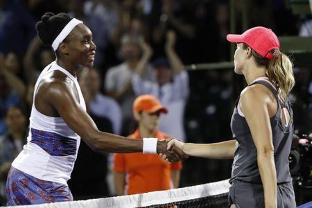Mar 28, 2018; Key Biscayne, FL, USA; Danielle Collins of the United States shakes hands with Venus Williams of the United States (L) after their match on day nine at the Miami Open at Tennis Center at Crandon Park. Colins won 6-2, 6-3. Geoff Burke-USA TODAY Sports