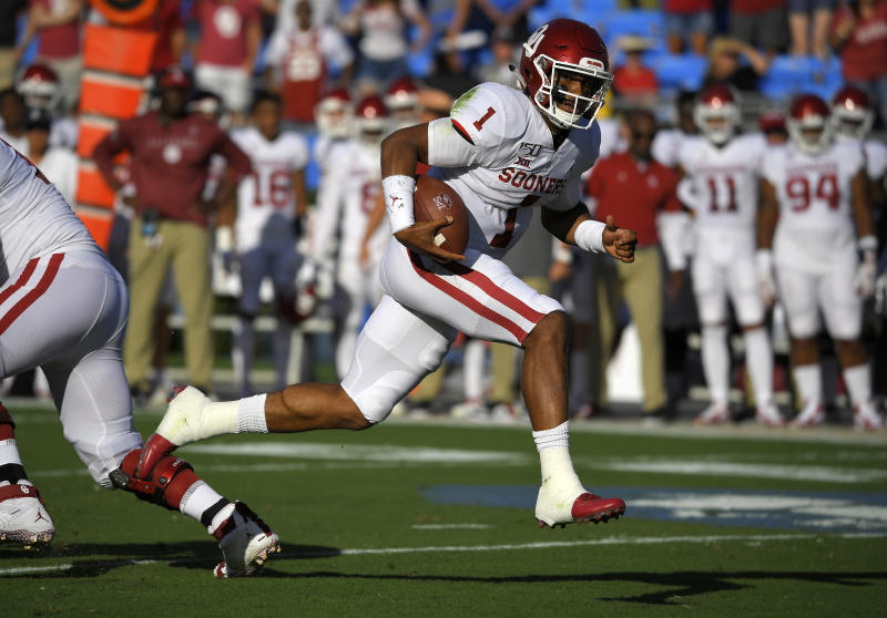 Oklahoma quarterback Jalen Hurts runs in for a touchdown during the first half of the team's NCAA college football game against UCLA on Saturday, Sept. 14, 2019, in Pasadena, Calif. (AP Photo/Mark J. Terrill)