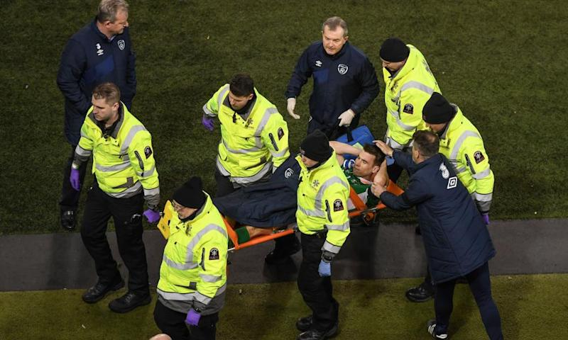 The Republic of Ireland assistant manager, Roy Keane, commiserates with Séamus Coleman after his injury in Dublin.