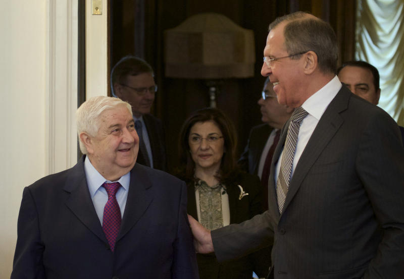 Russian Foreign Minister Sergey Lavrov, right, welcomes Syrian Foreign Minister Walid al-Moallem, left, in Moscow, Monday, Feb. 25, 2013. (AP Photo/Ivan Sekretarev)