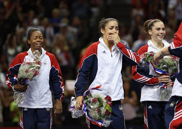 Gabrielle Douglas, Alexandra Raisman and McKayla Maroney react after being named to the US Gymnastics team going to the 2012 London Olympics at HP Pavilion on July 1, 2012 in San Jose, California. (Photo by Ezra Shaw/Getty Images)