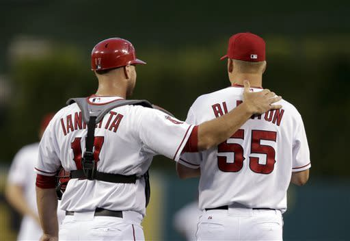 Los Angeles Angels catcher Chris Iannetta, left, talks to starting pitcher Joe Blanton during the first inning of a baseball game against the Texas Rangers in Anaheim, Calif., Monday, April 22, 2013. (AP Photo/Jae C. Hong)