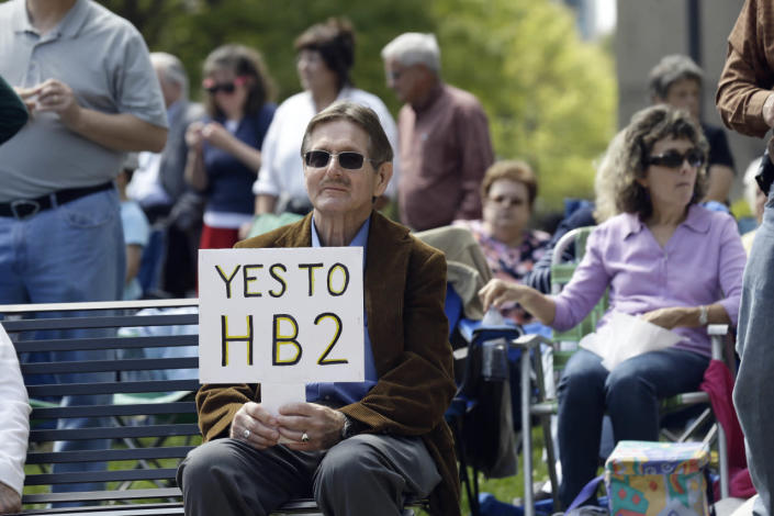 <p>Supporters of House Bill 2 gather at the North Carolina State Capitol in Raleigh on April 11, 2016, during a rally in support of the controversial law.<i> (Gerry Broome/AP)</i></p>