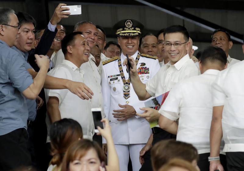 FILE - In this Sept. 24, 2019, file photo, new Philippine Armed Forces chief Lt.Gen. Noel Clement, center, poses with his batchmates at the Philippine Military Academy prior to the change of command ceremony in Manila, Philippines. Despite new South China Sea tensions between Manila and Bejing, Clement says the chance of an armed conflict breaking out between the sides remains very low. (AP Photo/Bullit Marquez, File)