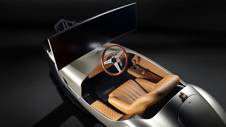 The curved Dell monitor provides an immersive experience. - Credit: RM Sotheby's
