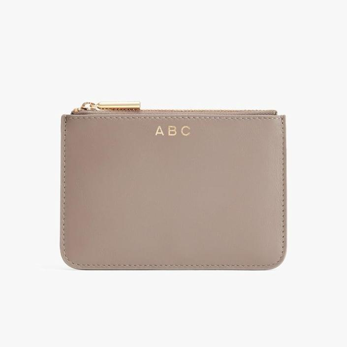 <p>This <span>Cuyana Slim Leather Pouch</span> ($40) will be their new favorite wallet.</p>