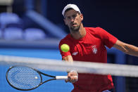 Novak Djokovic, of Serbia, practices at the Ariake Tennis Center ahead of the 2020 Summer Olympics, Friday, July 23, 2021, in Tokyo, Japan. (AP Photo/Seth Wenig)