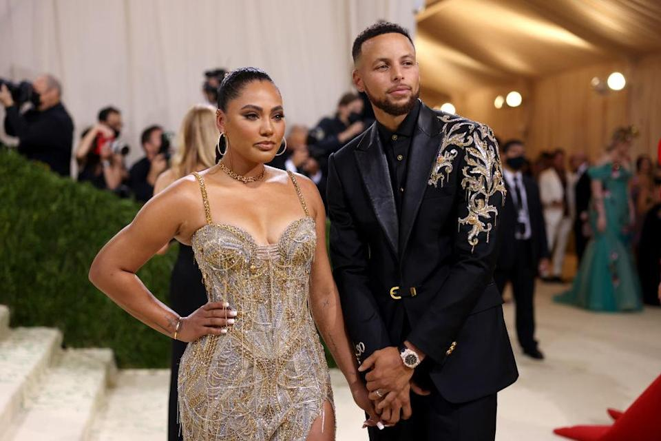 A close up ofStephen Curry and Ayesha Curry as they pose on the Met Gala red carpet