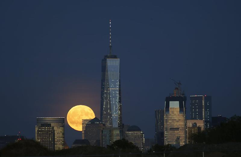 NEWARK, NJ - SEPTEMBER 16: A full harvest moon rises behind Lower Manhattan and One World Trade Center in New York City on September 16, 2016 as seen from Newark, NJ. (Photo by Gary Hershorn/Getty Images)