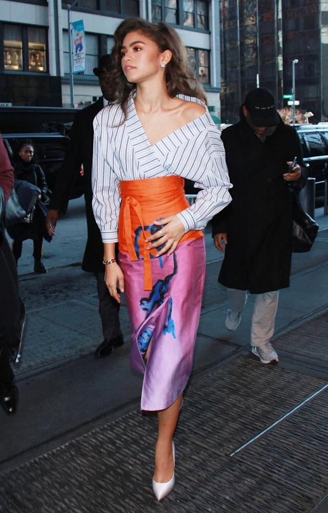 <p>One of Zendaya's many colorful looks, this Stella Jean Resort 2018 top and skirt were paired with shoes she wore earlier that morning. (Photo: Getty Images) </p>