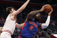 Chicago Bulls forward Luke Kornet, left, defends as Detroit Pistons center Andre Drummond (0) attempts to shoot during the first half of an NBA basketball game, Saturday, Jan. 11, 2020, in Detroit. (AP Photo/Carlos Osorio)
