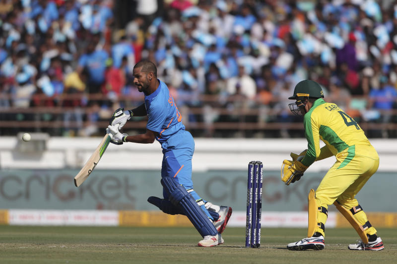 India's Shikhar Dhawan plays a shot during the second one-day international cricket match between India and Australia in Rajkot, India, Friday, Jan. 17, 2020. (AP Photo/Ajit Solanki)