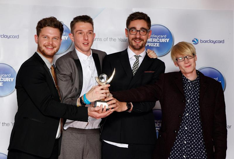 "FILE - This Nov. 1, 2012 file photo shows members of Alt-J, from left, Joe Newman, Thom Green, Gus Unger-Hamilton and Gwil Sainsbury at the Barclaycard Mercury Prize Albums of the Year awards 2012 at the Camden Roundhouse in London. Their debut album, ""An Awesome Wave,"" went on to win the prestigious Mercury Prize given to the top album of the year in the United Kingdom and Ireland. The Cambridge quartet has since been a near constant conversation piece on the blogosphere and mid-sized club circuit on both sides of the Atlantic Ocean. (Photo by John Marshall JME/Invision/AP)"