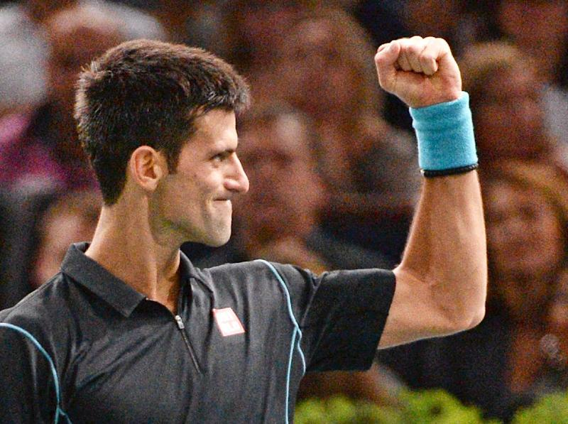 Serbia's Novak Djokovic reacts after winning his semifinal match against Switzerland's Roger Federer, at the Paris Masters tennis, in the Paris Bercy stadium, Saturday Nov. 2, 2013.(AP Photo/Christophe Saidi/Pool)