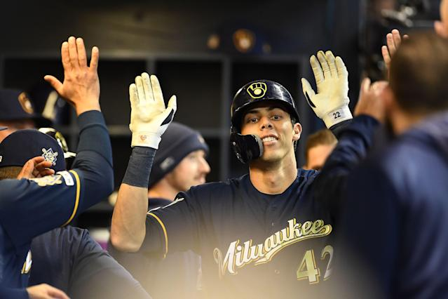 "<a class=""link rapid-noclick-resp"" href=""/mlb/teams/milwaukee/"" data-ylk=""slk:Brewers"">Brewers</a> outfielder <a class=""link rapid-noclick-resp"" href=""/mlb/players/9320/"" data-ylk=""slk:Christian Yelich"">Christian Yelich</a> celebrates after hitting his third home run of the day. (Photo by Stacy Revere/Getty Images)"