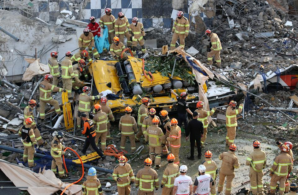 South Korean firefighters search for passengers among the rubble. Source: Reuters
