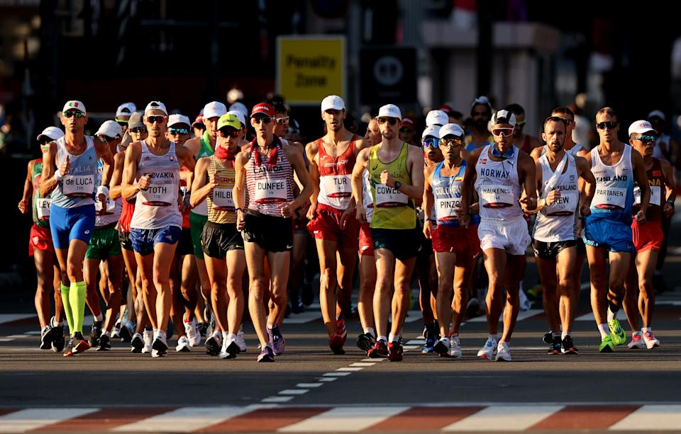 <p>Athletes compete in the Men's 50km Race Walk Final on day fourteen of the Tokyo 2020 Olympic Games at Sapporo Odori Park on August 06, 2021 in Sapporo, Japan. (Photo by Clive Brunskill/Getty Images)</p>