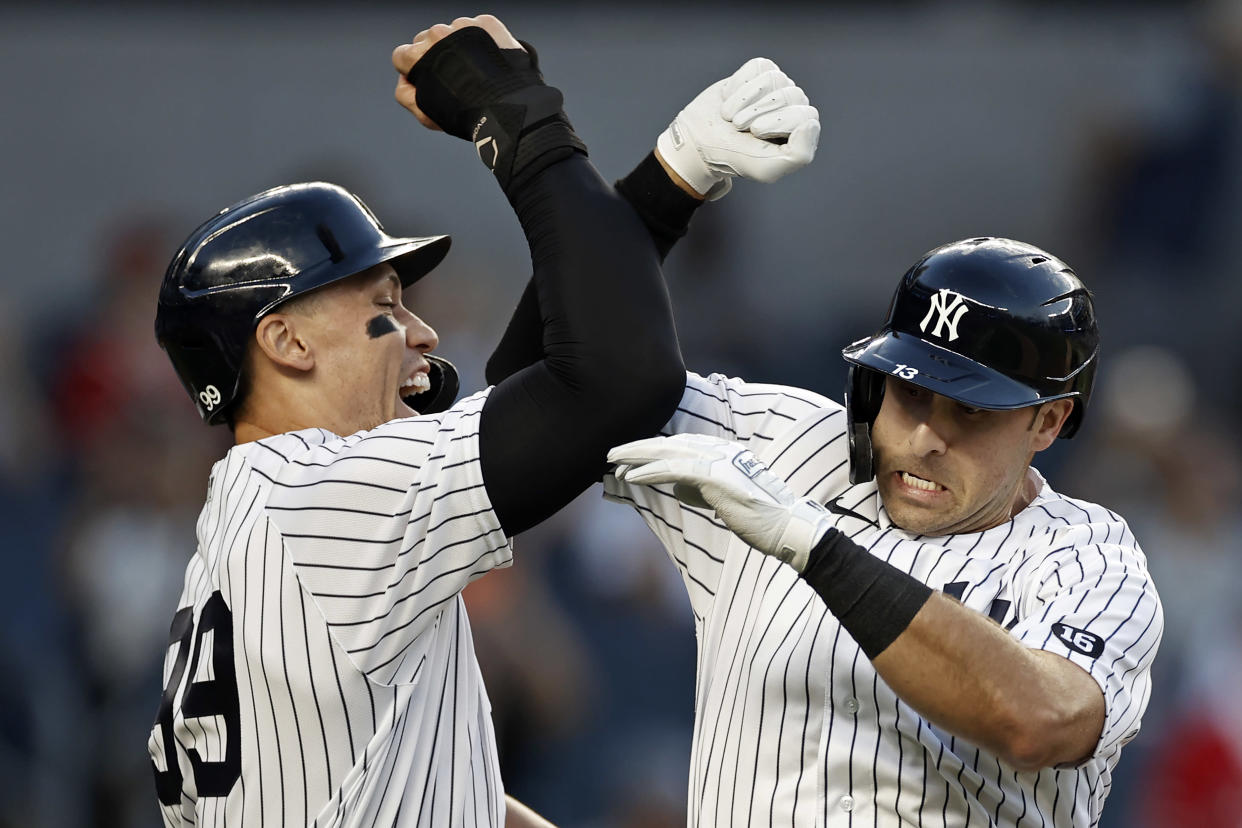 Joey Gallo (right) of the New York Yankees celebrates with Aaron Judge  after hitting a two-run home run against the Angels on Monday. (Photo by Adam Hunger/Getty Images)
