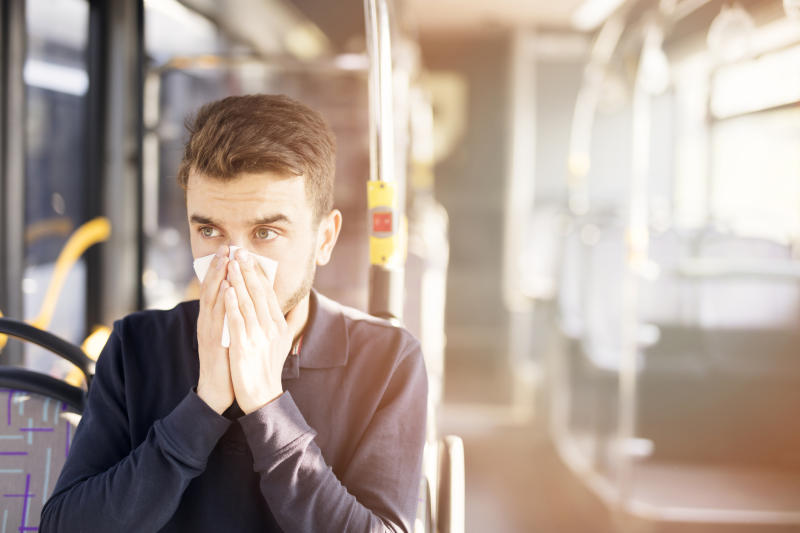 Should you move away from someone sneezing on your commute? (Getty)
