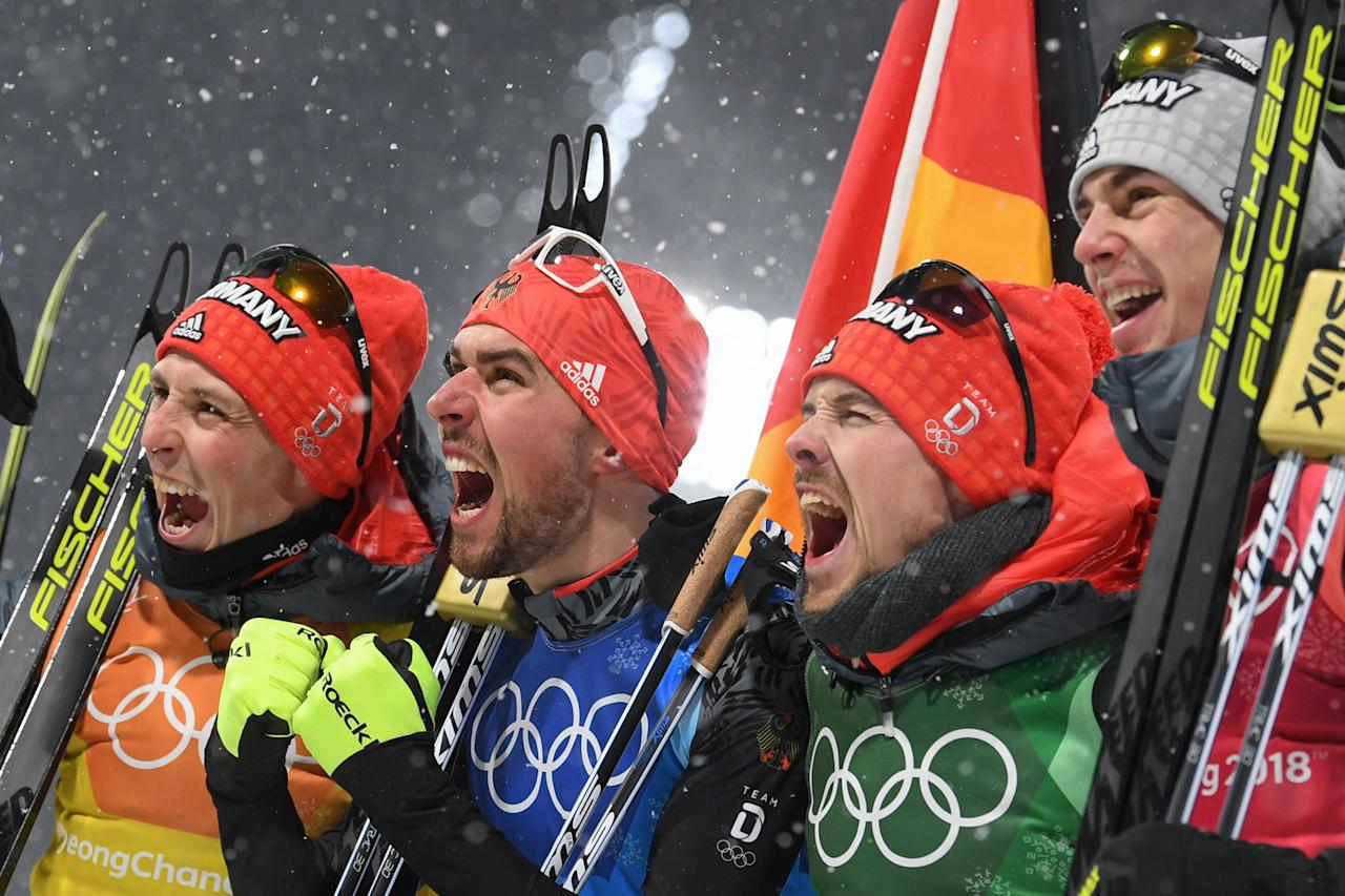 <p>Germany's Johannes Rydzek, Vinzenz Geiger, Fabian Riessle, and Eric Frenzel celebrate winning gold during the Nordic Combined Team Gundersen LH/4x5km, Cross-Country at the 2018 Winter Olympic Games in PyeongChang, South Korea, February 22, 2018.<br /> (Photo by Christof Stache/AFP/Getty Images) </p>