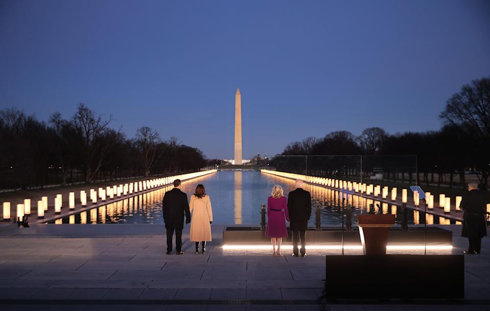 Biden, Harris and their spouses honored the nation's COVID-19 victims as 400 lights glow between the Washington Monument and Lincoln Memorial. (Photo: Chip Somodevilla via Getty Images)