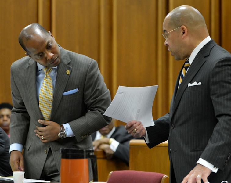 Eric Barnum, left, attorney for Bernice King looks over paperwork held by William Hill, attorney for the Estate of Dr. Martin Luther King Jr. Inc., as they appear in Fulton County Superior Court on Wednesday, Feb. 19, 2014, in the first hearing in the case that has pitted brothers Martin Luther King III and Dexter King against Bernice King over the possession of their father's Nobel Peace Prize and personal Bible. The brothers are seeking a restraining order against their sister, Bernice. (AP Photo/Atlanta Journal-Constitution, Kent D. Johnson) MARIETTA DAILY OUT; GWINNETT DAILY POST OUT; LOCAL TV OUT; WXIA-TV OUT; WGCL-TV OUT.
