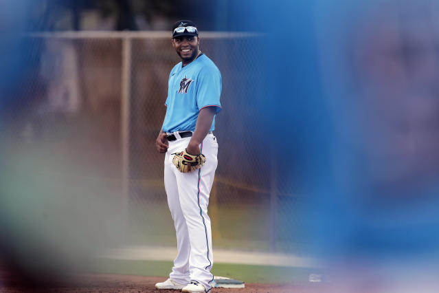 Miami Marlins infielder Jesus Aguilar waits for drills to begin at first base during a spring training baseball practice Wednesday, Feb. 19, 2020, in Jupiter, Fla. (AP Photo/Brynn Anderson)
