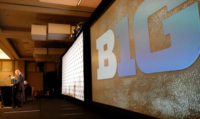 Big Ten commissioner Jim Delany, left, speaks to the media at the Big Ten NCAA college football media days, Tuesday, July 26, 2016 in Chicago. (AP Photo/Tae-Gyun Kim)