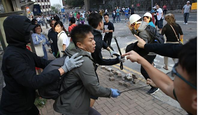 Clashes between anti-government protesters and residents near the University of Hong Kong. Photo: Winson Wong