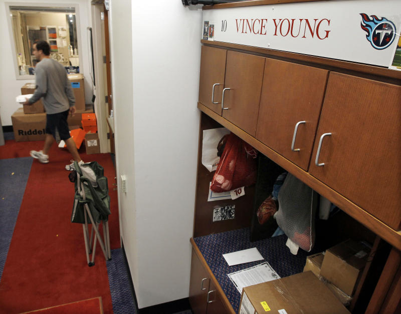 Items sit in the locker of Tennessee Titans quarterback Vince Young at the team's practice facility on Monday, Jan. 3, 2011, in Nashville, Tenn. The Titans' playoff hopes that came with a 5-2 start in the season disappeared with injuries to Young and eight losses in their final nine games. (AP Photo/Mark Humphrey)