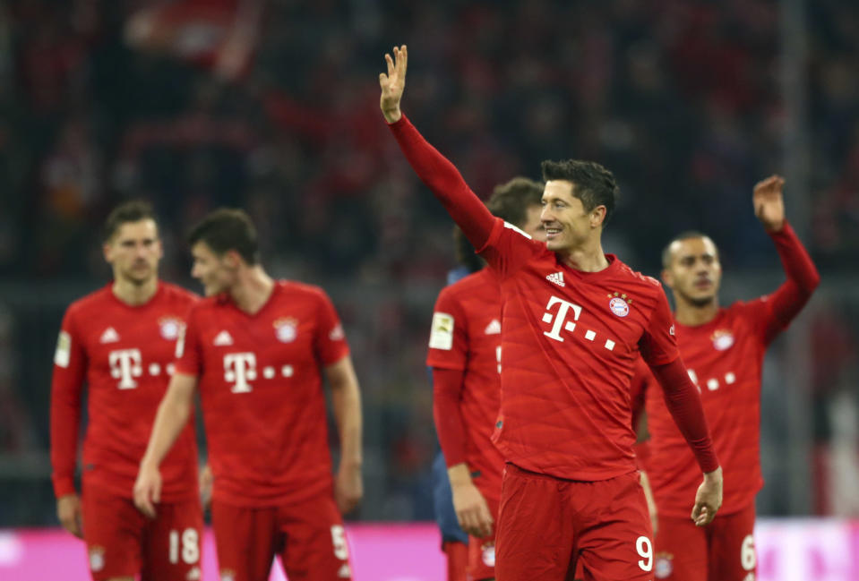 Bayern's Robert Lewandowski, front right, waves to supporters at the end of the German Bundesliga soccer match between FC Bayern Munich and Borussia Dortmund, in Munich, Germany, Saturday, Nov. 9, 2019. (AP Photo/Matthias Schrader)