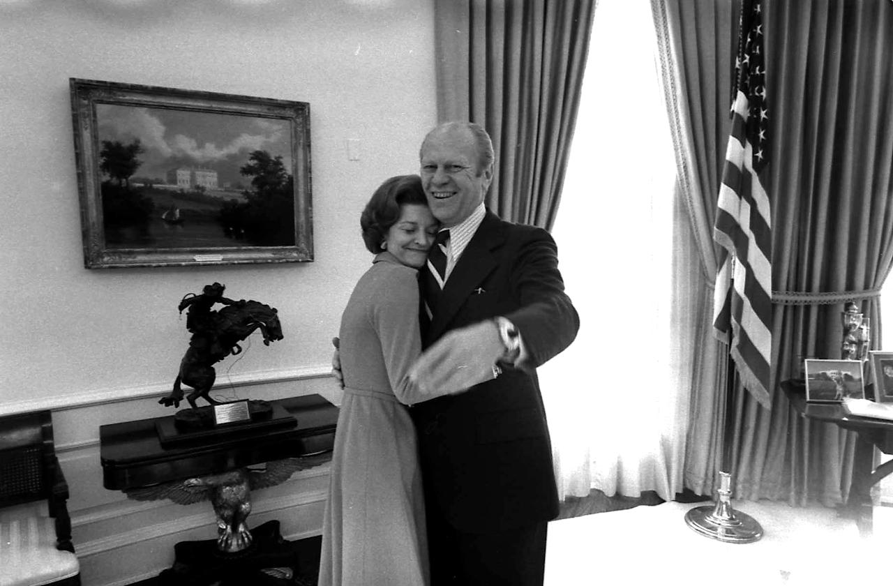 Handout of Betty Ford hugging her husband in the Oval Office of the White House