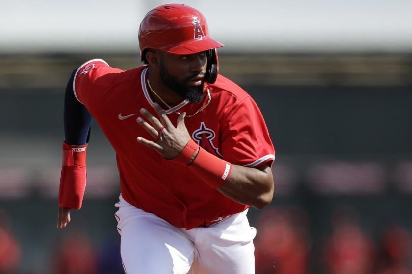 Los Angeles Angels' Jo Adell leads off from second base during the first inning of a spring training baseball game against the Colorado Rockies, Sunday, Feb. 23, 2020, in Tempe, Ariz. (AP Photo/Gregory Bull)
