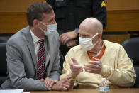 Joseph James DeAngelo, right, speaks with public defender Joseph Cress at the end of the second day of victim impact statements at the Gordon D. Schaber Sacramento County Courthouse on Wednesday, Aug. 19, 2020, in Sacramento, Calif. Victims of California serial killer and rapist, DeAngelo want him in a maximum security prison far, far away if he can't spend the rest of his life on death row. But they may not hold much sway over where or how the 74-year-old former police officer is imprisoned once he is sentenced on Friday, Aug. 21. (Santiago Mejia/San Francisco Chronicle via AP, Pool)