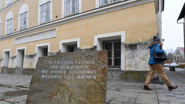 PHOTO: A woman walks past a memorial reading 'For peace, liberty and democracy. Never again Fascism' in front the house where Adolf Hitler was born, in Braunau, Austria, Nov. 20, 2019. (Andreas Gebert/Reuters)