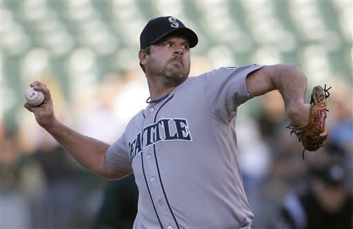 Seattle Mariners pitcher Kevin Millwood works against the Oakland Athletics during the first inning of a baseball game in Oakland, Calif., Friday, July 6, 2012. (AP Photo/Jeff Chiu)