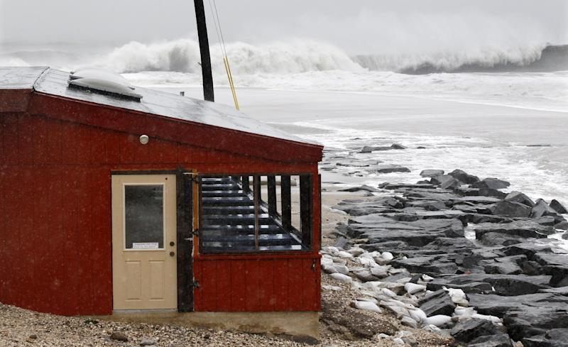 The dinning area of a small restaurant, The Cove, is threatened by the rough Atlantic Ocean Monday Oct. 29, 2012, in Cape May, N.J. Hurricane Sandy continued on its path Monday, as the storm forced the shutdown of mass transit, schools and financial markets, sending coastal residents fleeing, and threatening a dangerous mix of high winds and soaking rain. (AP Photo/Mel Evans)