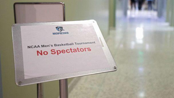 PHOTO: A sign reads 'No Spectators' prior to Yeshiva playing against Worcester Polytechnic Institute during the NCAA Division III Men's Basketball Championship, March 6, 2020, in Baltimore, Md. (Patrick Smith/Getty Images)