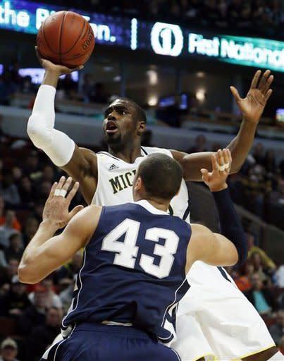 Michigan's Tim Hardaway Jr. shoots over Penn State's Ross Travis (43) during the first half of an NCAA college basketball game at the Big Ten tournament Thursday, March 14, 2013, in Chicago. (AP Photo/Charles Rex Arbogast)