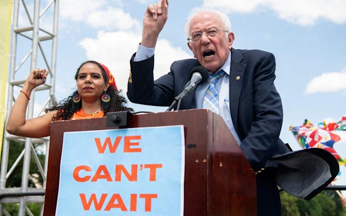 Bernie Sanders addressed a rally in Washington on Thursday, calling for spending on climate change and jobs - GETTY IMAGES
