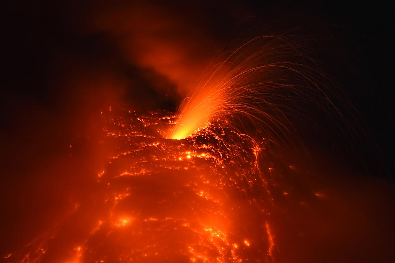 <p>A photo taken on Jan. 25, 2018 from the city of Legazpi, Albay province, south of Manila, shows a fiery fountaining during an eruption of the Mayon volcano as it emits molten lava. (Photo: Ted Aljibe/AFP/Getty Images) </p>