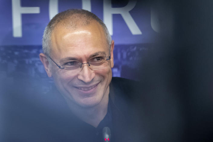 """FILE - In this Aug. 20, 2021, file photo, Russian opposition figure and former owner of the Yukos Oil Company Mikhail Khodorkovsky smiles during a news conference with Lithuania's Minister of Foreign Affairs Gabrielius Landsbergis after Vilnius Russia Forum at the """"Esperanza"""" hotel in Paunguriai village, Trakai district west of the capital Vilnius, Lithuania. Khodorkovsky, a Putin critic who moved to London after spending 10 years in prison on charges widely seen as political revenge. (AP Photo/Mindaugas Kulbis, File)"""
