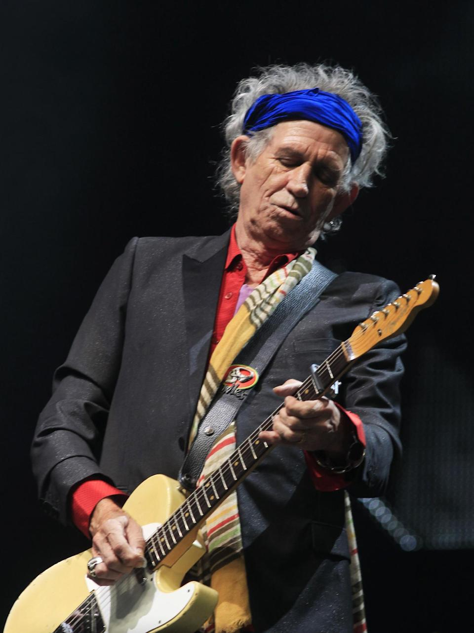 Keith Richards of The Rolling Stones performs at Glastonbury, England on Saturday, June 29, 2013. Thousands are to enjoy the three day festival that started on Friday, June 28, 2013 with headliners Arctic Monkeys, the Rolling Stones and Mumford and Sons. (Photo by Jim Ross/Invision/AP)