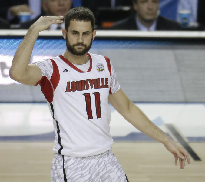 Louisville guard/forward Luke Hancock (11) reacts to play against the Michigan during the first half of the NCAA Final Four tournament college basketball championship game Monday, April 8, 2013, in Atlanta. (AP Photo/Chris O'Meara)