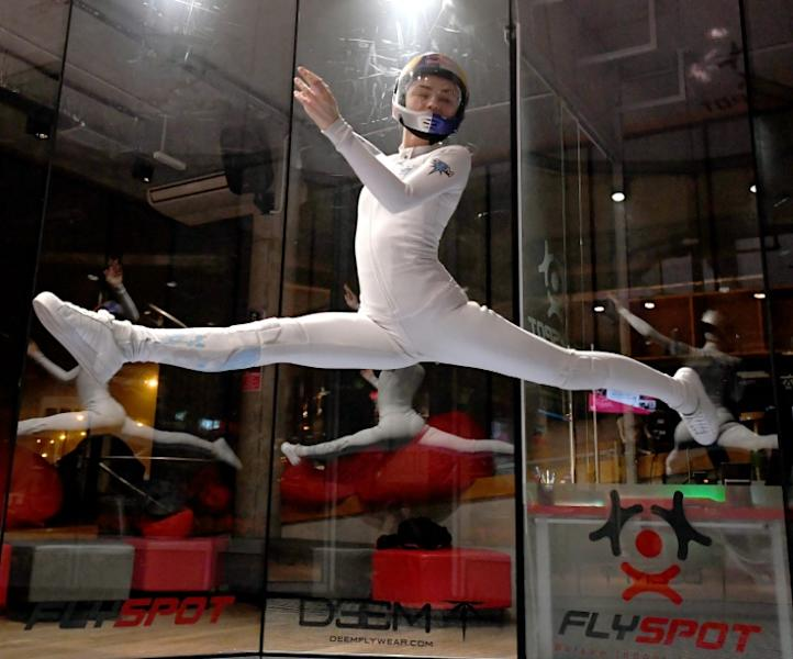 Maja Kuczynska, 17, makes airborne gymnastic moves during her skydiving performance inside a wind tunnel in Warsaw on February 19, 2017