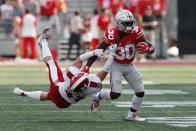 Ohio State running back Demario McCall, right, escapes the grasp of Miami (Ohio) defensive back Bart Baratti during the first half of an NCAA college football game Saturday, Sept. 21, 2019, in Columbus, Ohio. (AP Photo/Jay LaPrete)