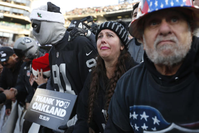 """Oakland Raiders fans in """"The Black Hole"""" watch their team walk off the field at the end of an NFL football game against the Jacksonville Jaguars n Oakland, Calif., Sunday, Dec. 15, 2019. (AP Photo/D. Ross Cameron)"""