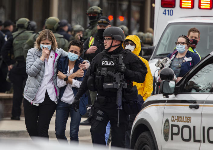 People are evacuated from a grocery store after a gunman opened fire in Boulder, Colo., Monday. (Chet Strange/Getty Images)